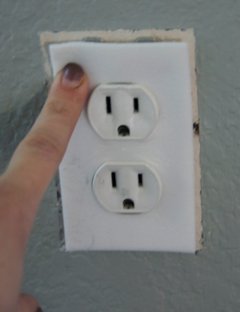 Insulation around outlet (excuse the bad paint job on my nails)